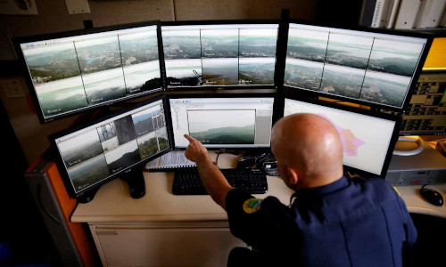 Battalion chief Michael Giannini points out details on screens showing images from cameras looking for wildfires at Marin County Fire Department headquarters.